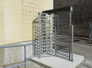image of a turnstile installation by Colonial Post and Fence